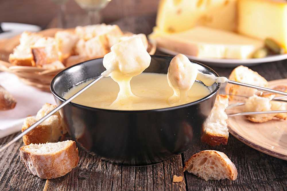 The beloved Swiss national dish consists of cheese melted down with white wine in a 'caquelon' pot heated by an open flame. — istock/margouillatphotos pic via AFP