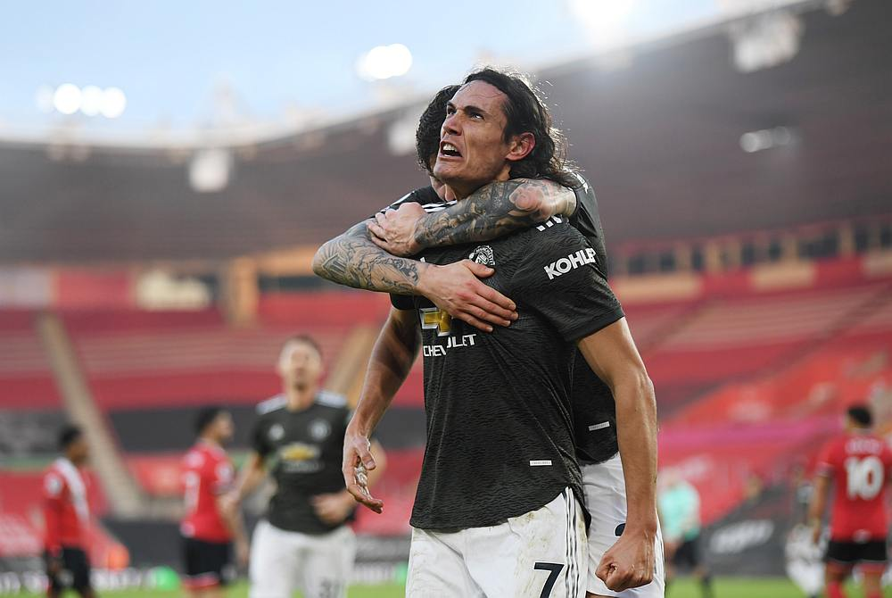Edinson Cavani celebrates scoring Manchester United's second goal with Victor Lindelof in their English Premier League match with Southampton at St Mary's Stadium, Southampton November 29, 2020. — Pool pic via Reuters