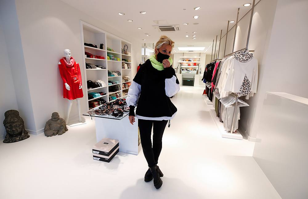 Arlette Kaballo, designer and owner of several fashion stores fixes her face mask as she stands in her empty store with no customers in the midst of Covid-19 outbreak in Cologne, Germany November 26, 2020. — Reuters pic