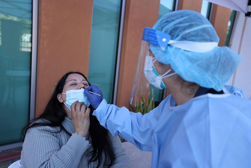 Rosio Osuna, 47, is tested for Covid-19, in East Los Angeles, California November 10, 2020. — Reuters pic