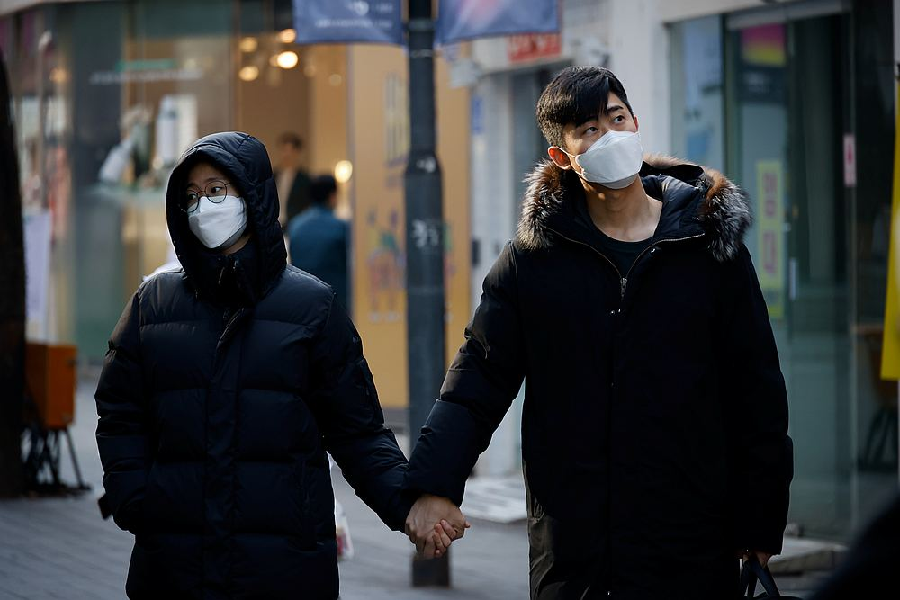 A couple walks in an empty shopping district amid the Covid-19 pandemic in Seoul, South Korea November 26, 2020. — Reuters pic