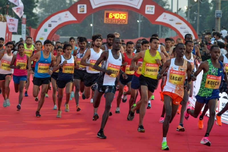 Athletes run from the start line during the 2019 Airtel Delhi half marathon in New Delhi. ― AFP pic