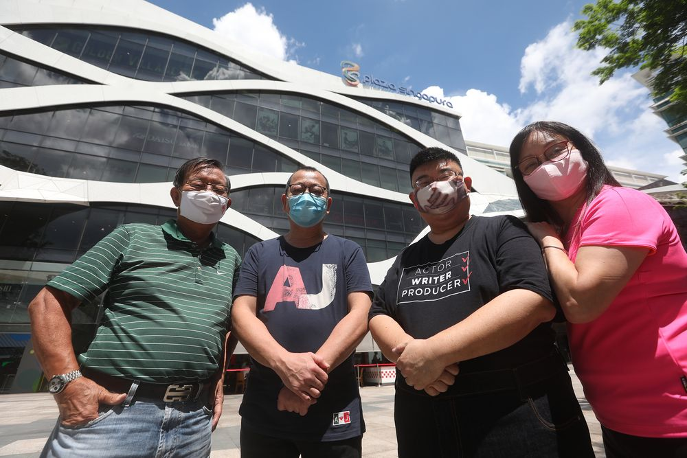 Former Yaohan staff (from left) Leslie Ee (financial controller); Richard Or (baker), Adrian Png (human resources) and Jenny Gan (cashier), photographed in front of Plaza Singapura, where a Yaohan outlet was once located. — TODAY pic