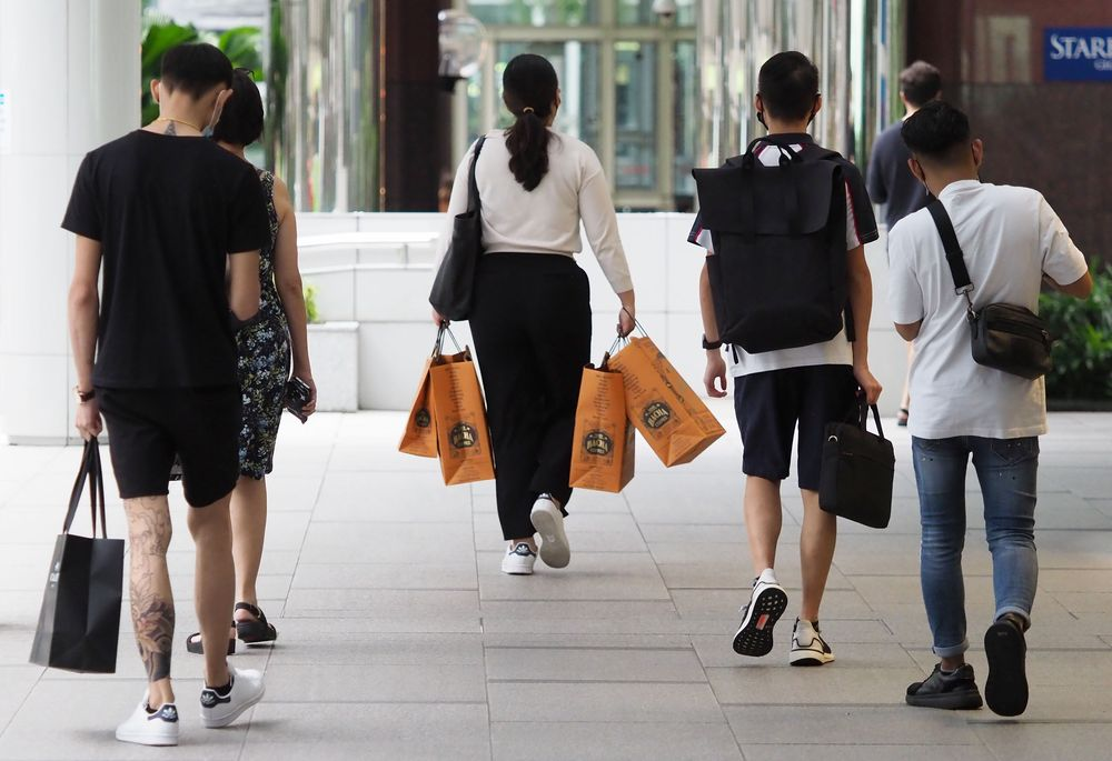 A survey found that close to 6 in 10 Singaporean millennials prefer shopping at a physical store. — TODAY pic
