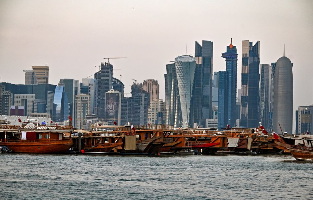 A view of boats moored in front of high-rise buildings in the Qatari capital, Doha. — AFP pic