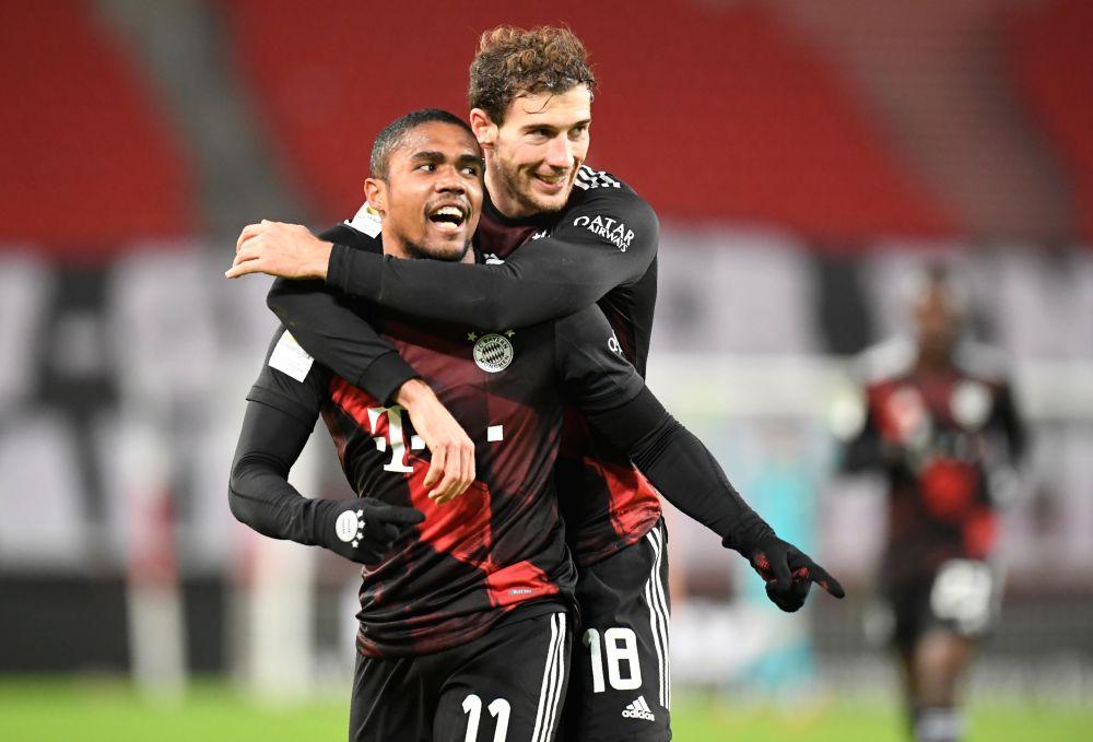 Bayern Munich's Douglas Costa celebrates scoring their third goal against VfB Stuttgart with Leon Goretzka at the Mercedes-Benz Arena, Stuttgart November 28,2020. — Reuters pic