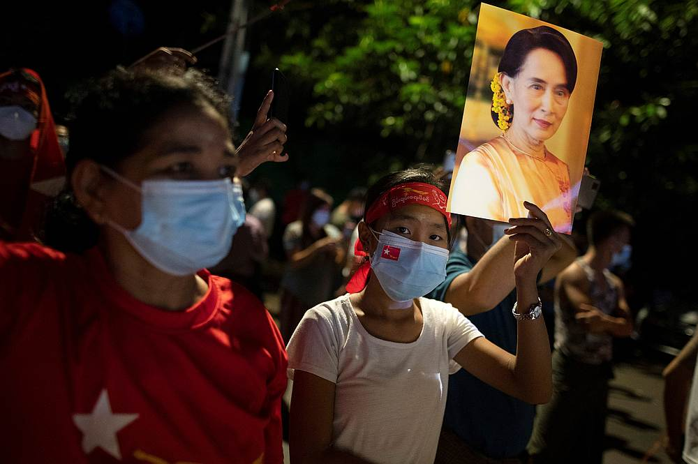 A supporter of National League for Democracy holds a picture of Myanmar State Counselor Aung San Suu Kyi as she waits for results outside the party headquarters in Yangon November 8, 2020. — Reuters pic