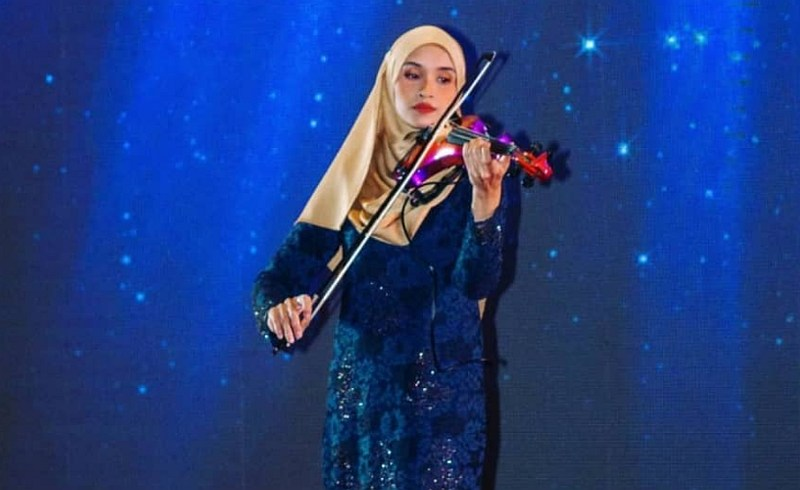 Endang worked hard to purchase her violin, and is grateful that caring Malaysians are trying to help her keep it. — Picture courtesy of Endang Hyder