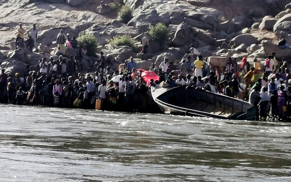 Ethiopians who fled the ongoing fighting in Tigray region prepare to cross the Setit River on the Sudan-Ethiopia border in Hamdait village in eastern Kassala state, Sudan, November 14, 2020. — Reuters pic