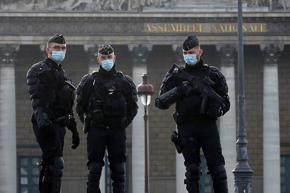 French gendarmes stand guard in front of the National Assembly in Paris November 24, 2020. — Reuters pic