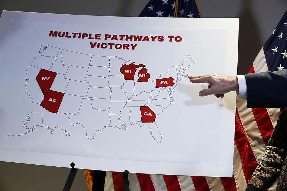 Rudy Giuliani, personal attorney to US President Donald Trump, gestures at a map of election swing states marked as Trump 'Pathways to Victory' during a news conference in Washington November 19, 2020. — Reuters pic