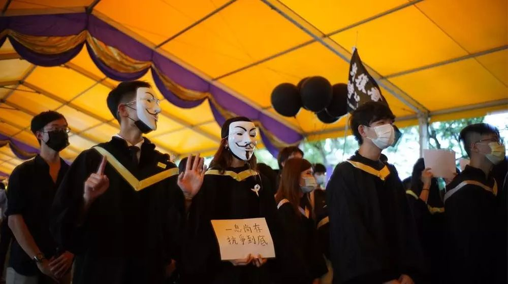 The Chinese University of Hong Kong (CUHK) students donned face masks to display outlawed slogans and defy the new national security law imposed by Beijing. — AFP pic