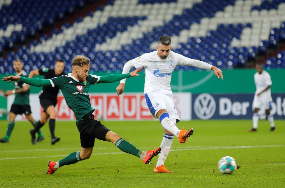 Schalke 04's Vedad Ibisevic (right) scores their first goal against FC Schweinfurt at the Veltins-Arena, Gelsenkirchen November 3, 2020. — Reuters pic