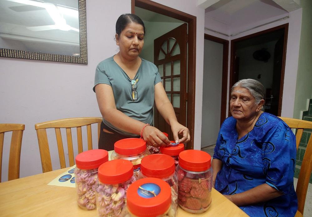 M. Indira Gandhi has taken to baking cookies to earn extra income this Deepavali.