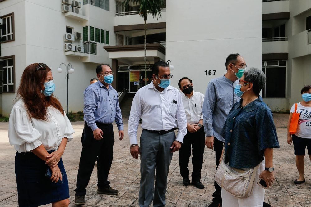 Penang state exco Jagdeep Singh Deo (centre) speaks to a resident at the Gurney Park Condominium in George Town November 17, 2020. — Picture by Sayuti Zainudin