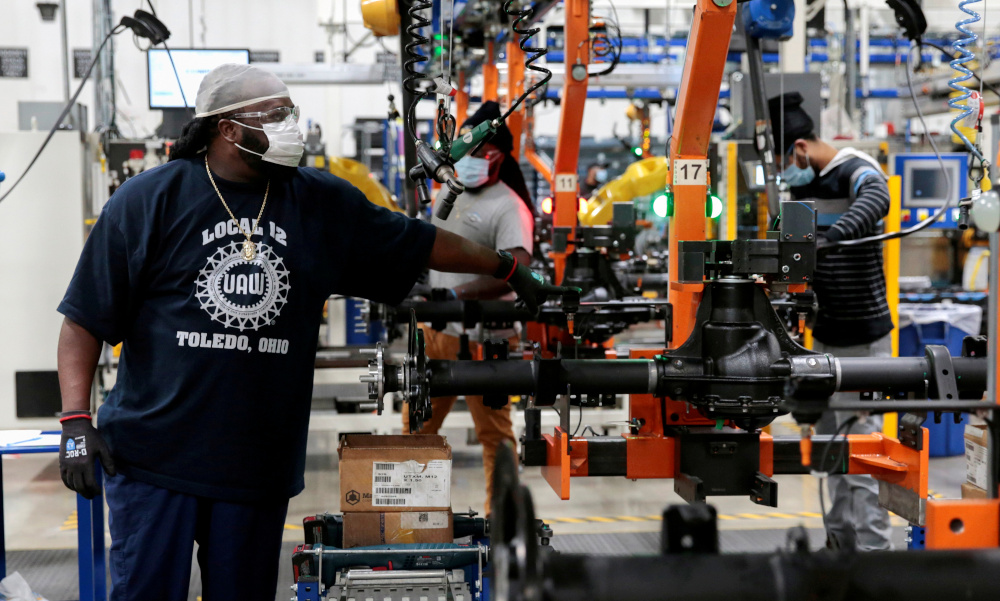 Dana Inc assembly technicians wear face masks as they assemble axles for automakers, as the auto industry begins reopening amid the coronavirus disease outbreak, at the Dana plant in Toledo, Ohio, US, May 18, 2020. — Reuters pic