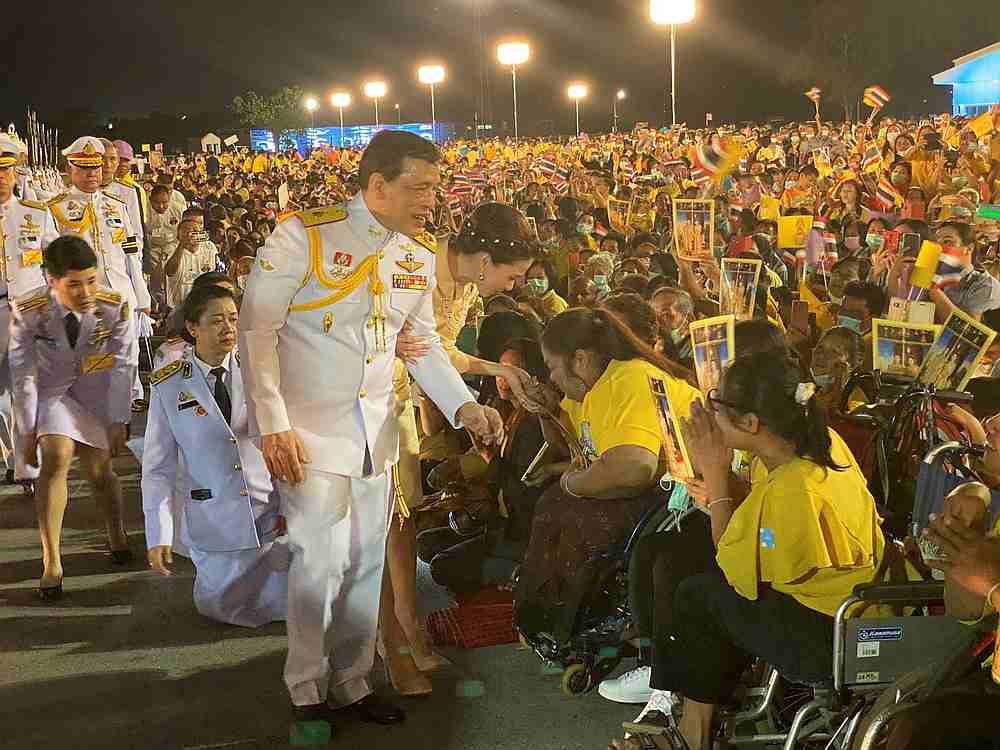 Thailand's King Maha Vajiralongkorn and Queen Suthida greet royalists at an airport in Udon Thani province, Thailand November 10, 2020. — Royal Household Bureau handout via Reuters