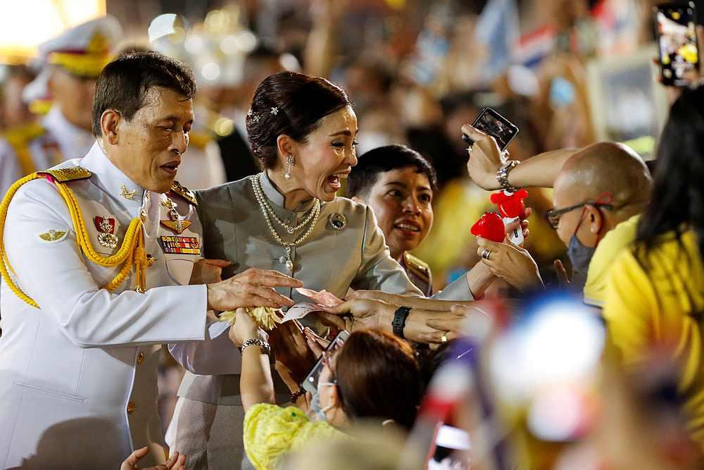 Thailand's King Maha Vajiralongkorn and Queen Suthida greet royalists at The Grand Palace in Bangkok, Thailand November 1, 2020. — Reuters pic