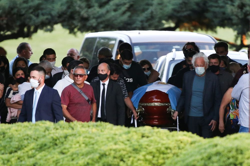 Friends and family carry the casket of football legend Diego Armando Maradona, at the cemetery in Buenos Aires November 26, 2020. ― Reuters pic