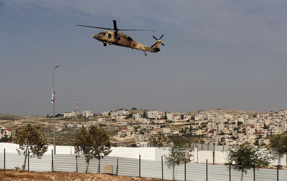 An Israeli air force Blackhawk helicopter carrying US Secretary of State Mike Pompeo hovers in the settlers industrial park of Sha'ar Binyamin near the Israeli Psagot settlement in the occupied West Bank north of Jerusalem