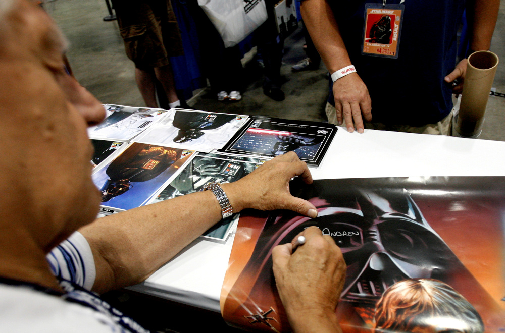 Actor David Prowse, who portrayed Darth Vader, signs autographs during the opening day of 'Star Wars Celebration IV' in Los Angeles in this file photo taken on May 24, 2007. — Reuters pic
