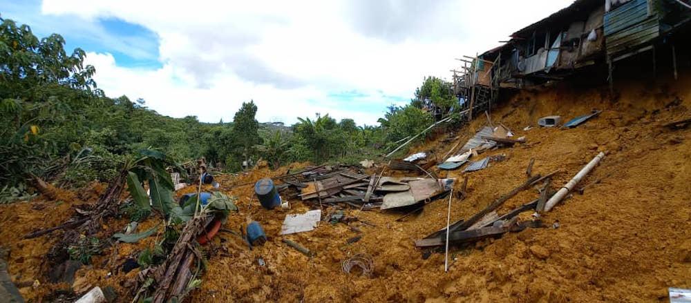 The back portion of Rh Jarau, Kampung Dayak, Sungai Plan in Bintulu affected by a landslide. — Borneo Post pic