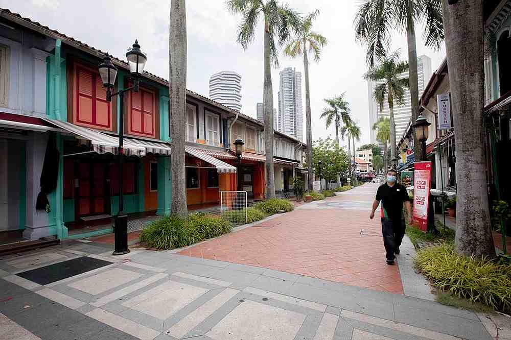 Shops along Bussorah Street, Singapore seen closed May 29, 2020. Two new schemes have been rolled out to help small- and medium-sized enterprises restructure their debts. — TODAY pic