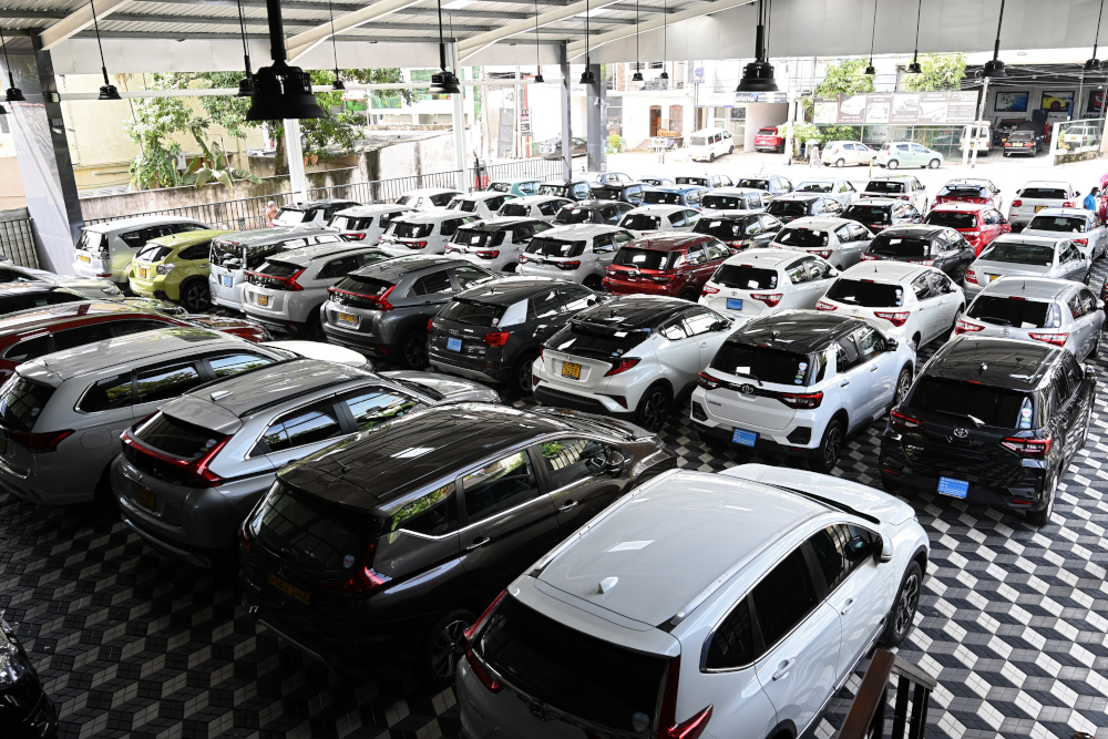 Cars are seen parked at a showroom in Colombo on November 17, 2020. Fitch said Sri Lanka's 2021 budget unveiled last week foreseeing a US$8.45 billion deficit in 2021 lacked a 'credible fiscal consolidation strategy'. — AFP pic
