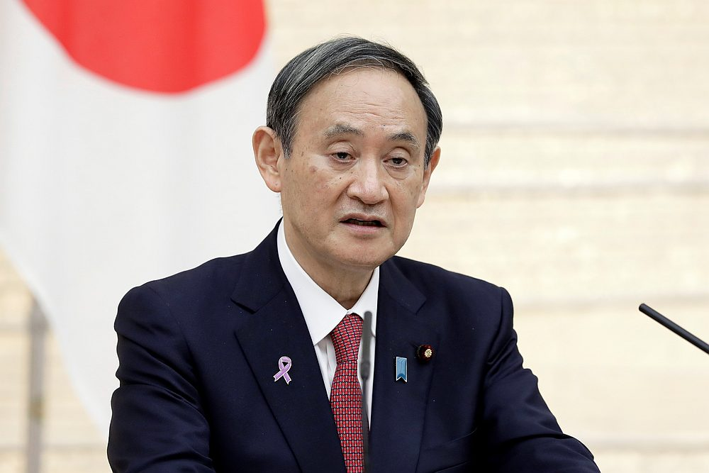 Prime Minister Yoshihide Suga has been wary about taking measures that would hamper economic activity, while he has put on a brave face against the mounting challenges of hosting the delayed Olympics in Tokyo this year. — Pool pic via Reuters