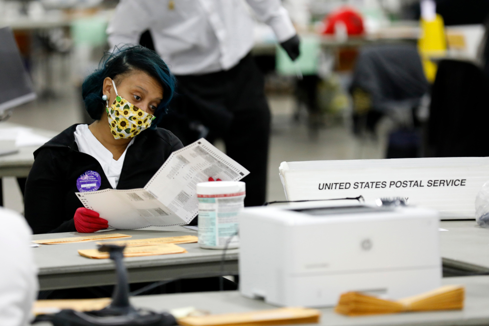 File picture shows Detroit election workers counting absentee ballots for the 2020 general election at TCF Center November 4, 2020 in Detroit, Michigan. — AFP pic