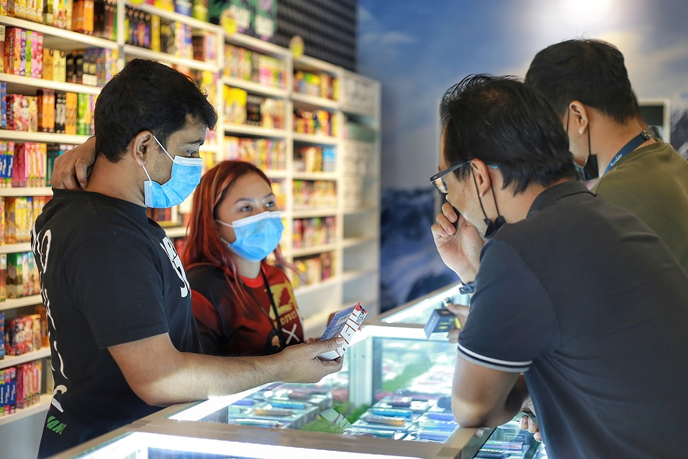 Customers buying vaping products inside a vape shop in Kuala Lumpur.