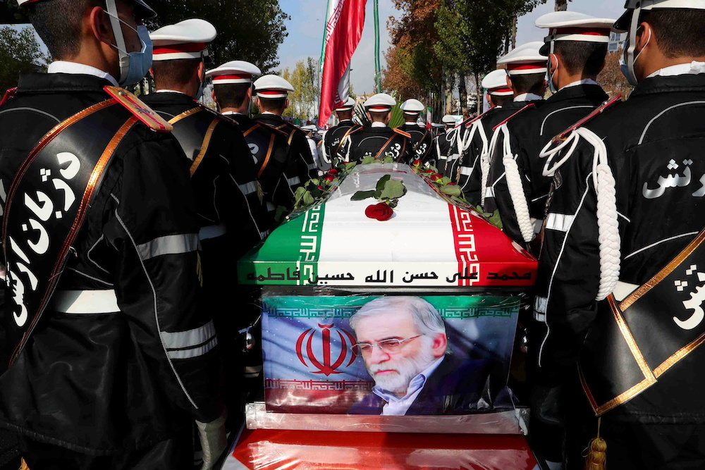 Members of Iranian forces carry the coffin of Iranian nuclear scientist Mohsen Fakhrizadeh during a funeral ceremony in Tehran, Iran November 30, 2020. — Iranian Defense Ministry/WANA (West Asia News Agency) handout via Reuters