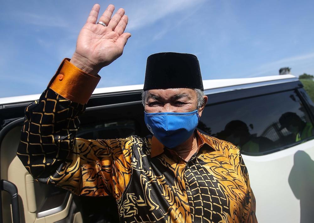 Umno President Datuk Seri Ahmad Zahid Hamidi waves as he leaves Istana Kinta in Ipoh December 6, 2020. — Picture by Farhan Najib