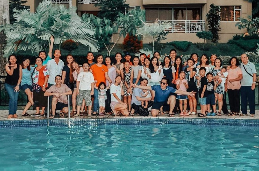Deiseree Daniel (centre, with baby) usually goes home to Kota Kinabalu for a big year-end family gathering like this one last year. It will be a sombre affair for the family this year. — Picture courtesy of Deiseree Daniel