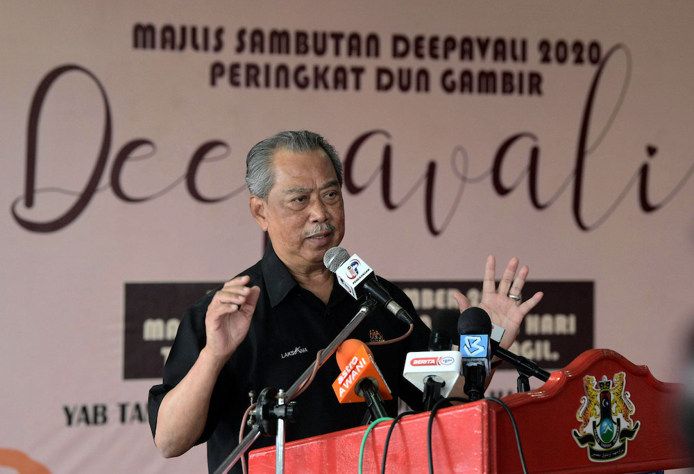 Prime Minister Tan Sri Muhyiddin Yassin gives a speech at the Gambir state constituency Deepavali 2020 celebrations, December 13, 2020. — Bernama pic