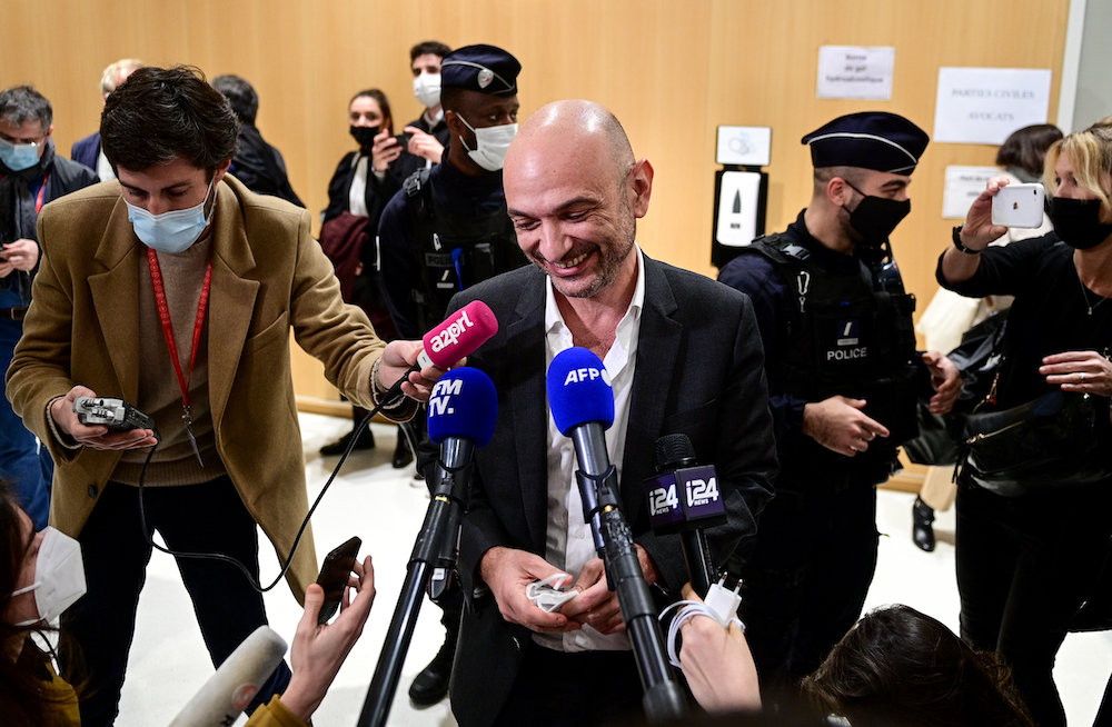Charlie Hebdo's lawyer Richard Malka talks to the press at the Paris' courthouse, December 16, 2020, after the sentencing hearing in the trial of 14 people suspected of being accomplices in the Charlie Hebdo and Hyper Cacher jihadist killings. — AFP pic