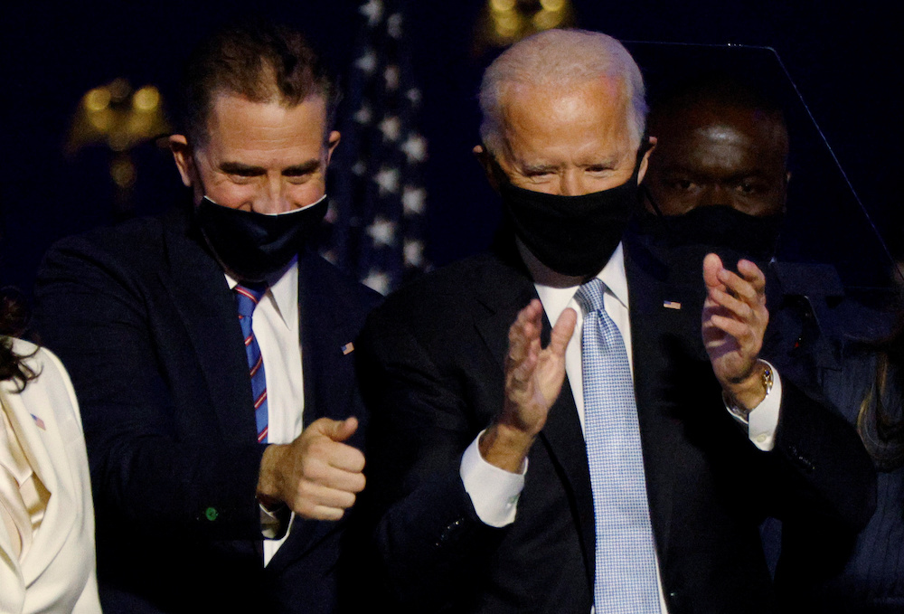 Hunter Biden (left, with his father US President Joe Biden) said his father's name had attracted the firm to him . — Reuters pic