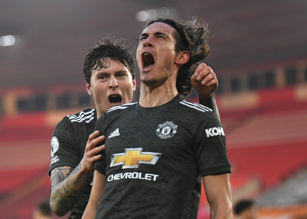 Manchester United's Edinson Cavani celebrates scoring their second goal with Victor Lindelof during their match against Southampton at the St Mary's Stadium in Southampton November 29, 2020. — Pool pic via Reuters