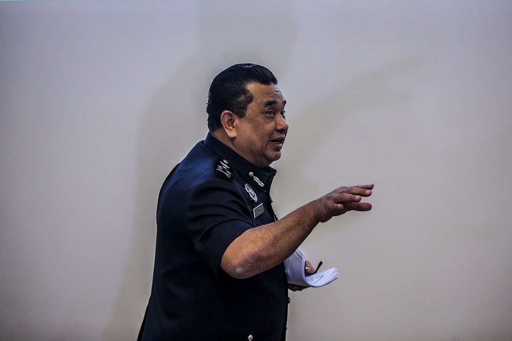 Bukit Aman Criminal Investigation Department (CID) director Datuk Huzir Mohamed leaves after a press conference at Bukit Aman in Kuala Lumpur December 1, 2020. — Picture by Hari Anggara
