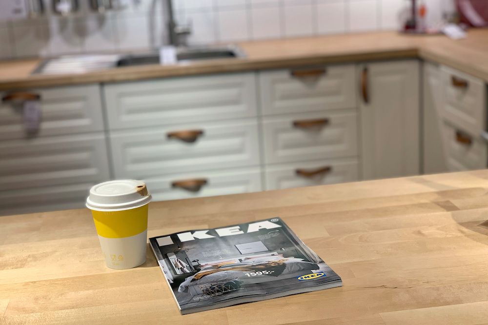 A left-behind coffee cup sits next to the 2021 catalogue on a showroom kitchen counter at an IKEA store on the outskirts of Stockholm, Sweden December 5, 2020. — Reuters pic