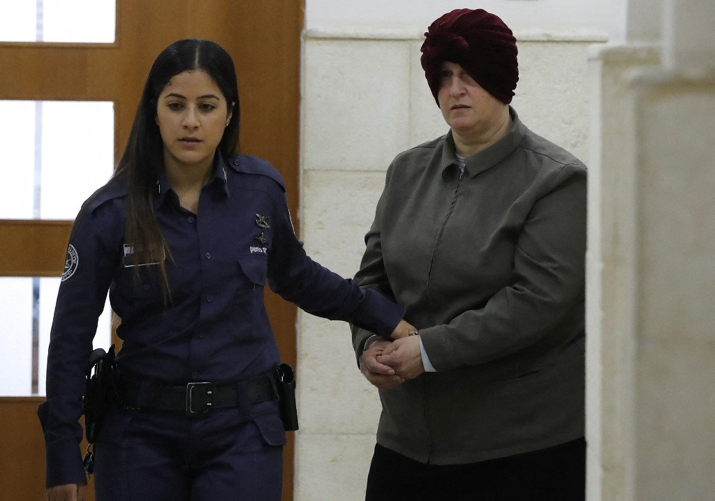 In this photo taken on February 27, 2018 Malka Leifer, a former Australian teacher accused of dozens of cases of sexual abuse of girls at a school, arrives for a hearing at the District Court in Jerusalem. — AFP pic
