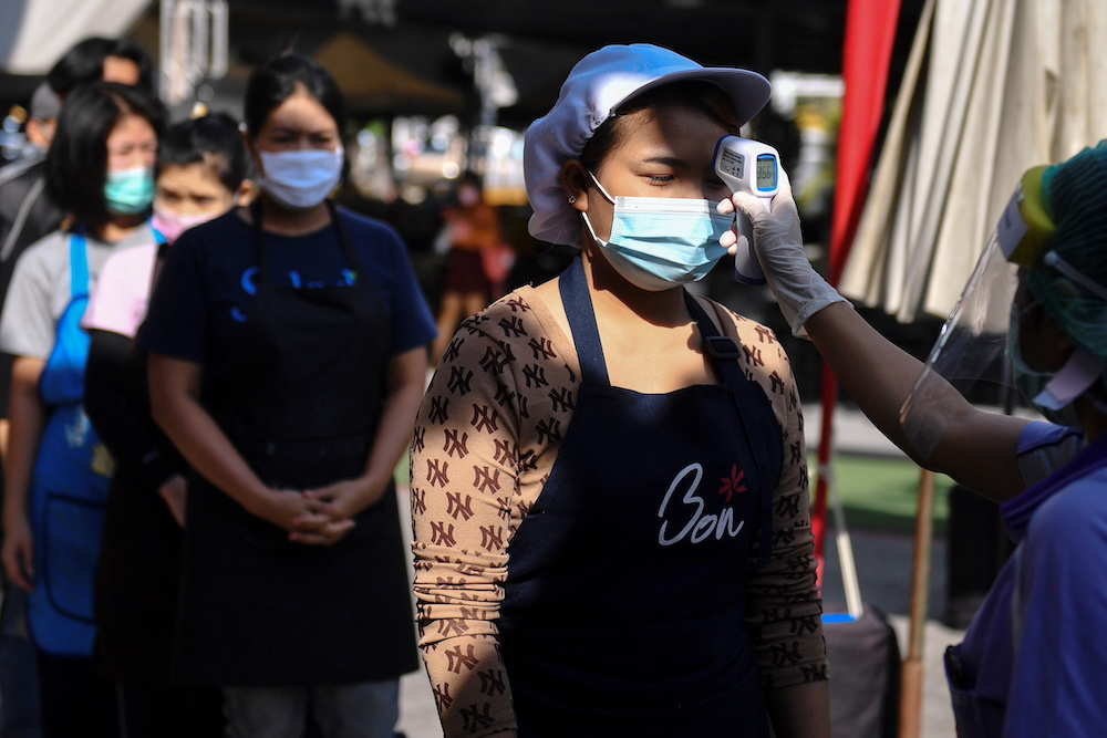 Thailand to test over 10,000 people after record Covid-19 surge
