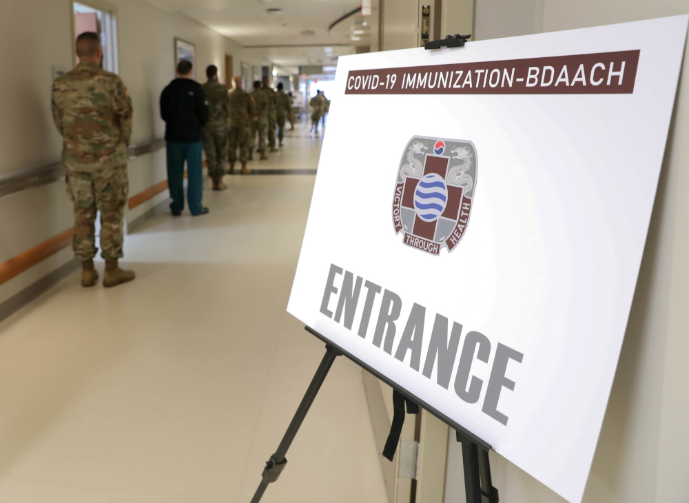 Service members wait in a line to get a coronavirus disease vaccine at Allgood Army Community Hospital located inside US Army Garrison Humphreys in Pyeongtaek, South Korea, December 29, 2020. — Spc Erin Conway/US Army/DVID handout pic via Reuters