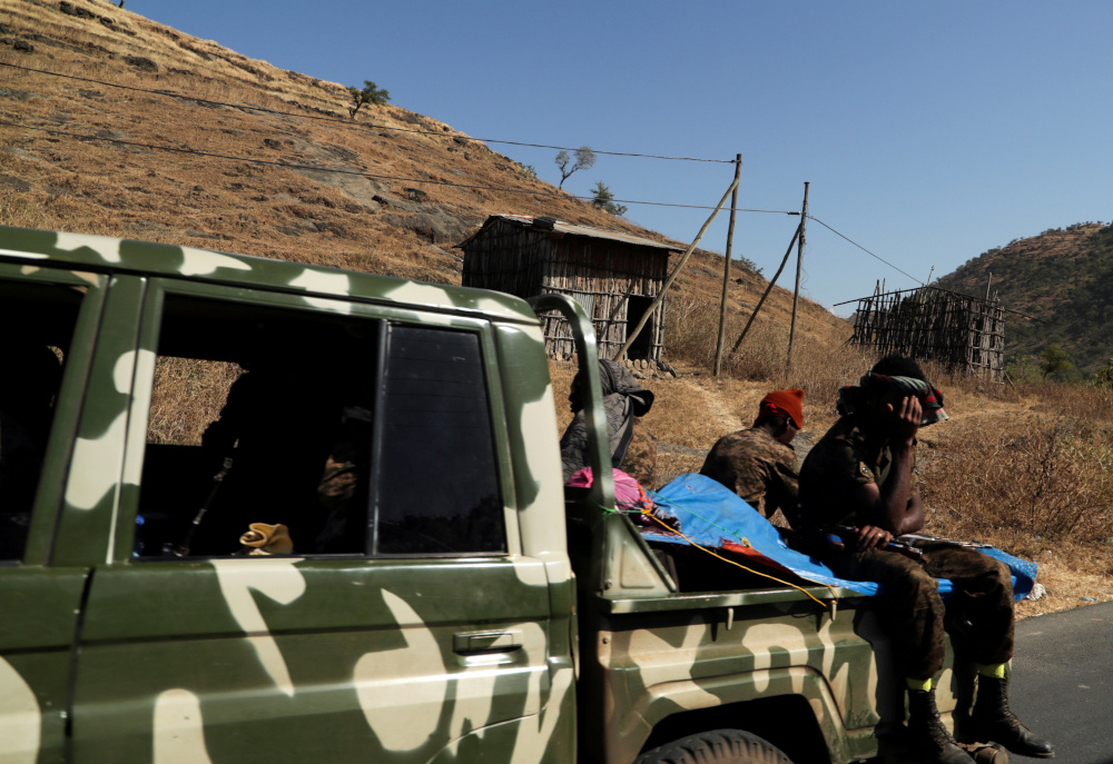 Members of the Ethiopian National Defense Force ride on their pickup truck as they head to mission in Sanja, Amhara region, near a border with Tigray, Ethiopia November 9, 2020. — Reuters pic