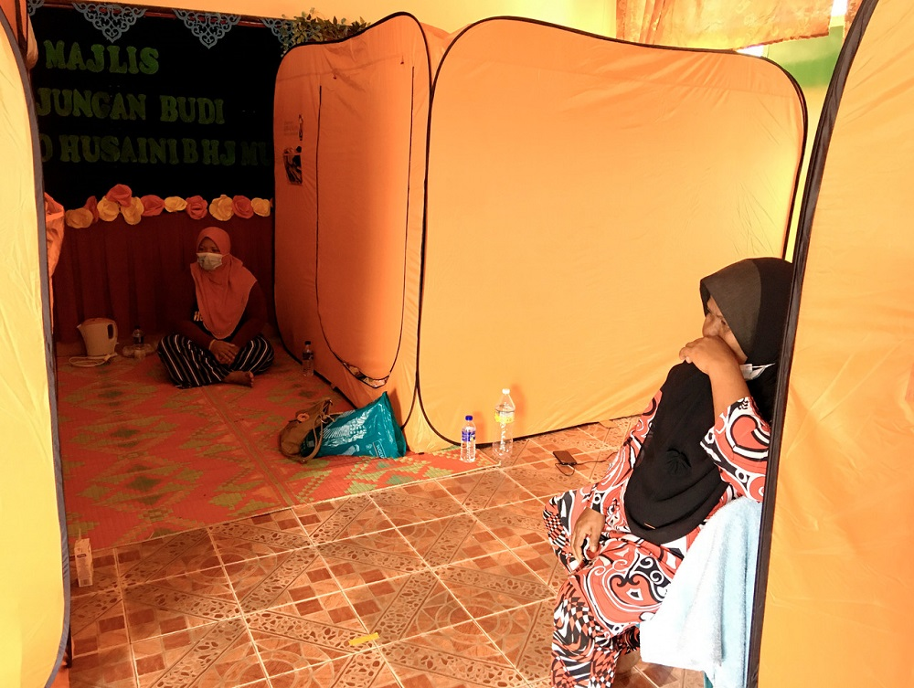 Flood victims rest at a temporary evacuation centre at Sekolah Kebangsaan (SK) Parit Gantong in Jasin November 30, 2020. — Bernama pic