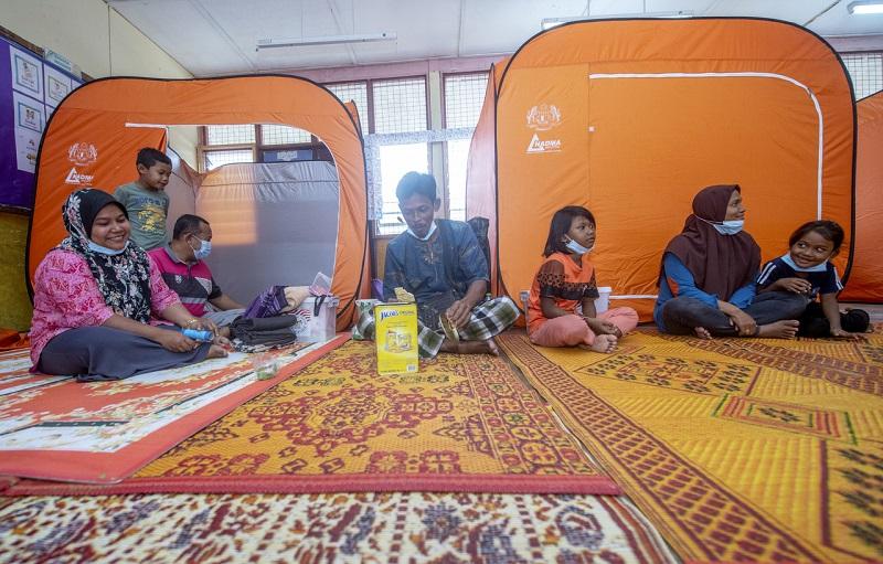 Flood victims rest at the relief centre at SK Kampung Lawang in Tanah Merah December 18, 2020. — Bernama pic