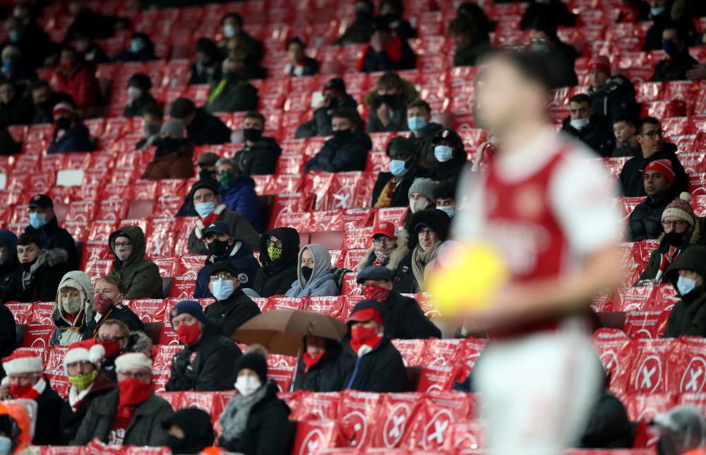Arsenal fans watch Arsenal's Kieran Tierney at the Emirates Stadium, London, Britain, December 13, 2020. — Reuters pic