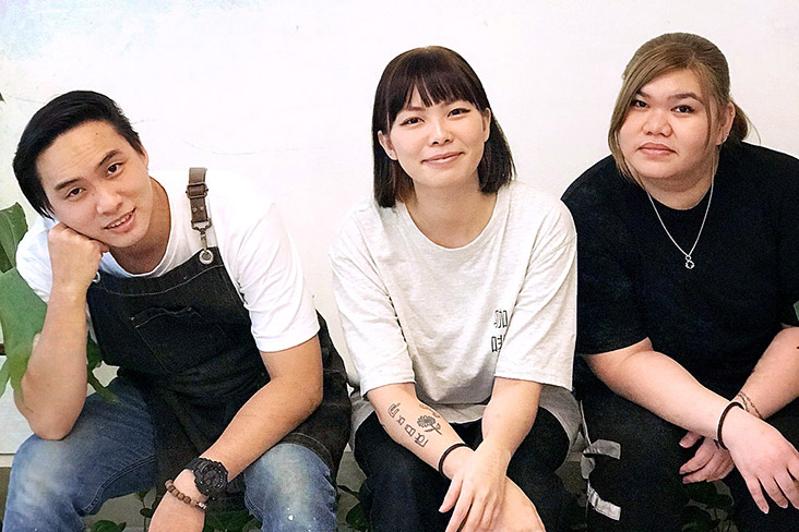 KITA Coffee's Rain Lee (centre) with her brother Alan (left) and cousin Jankis (right).