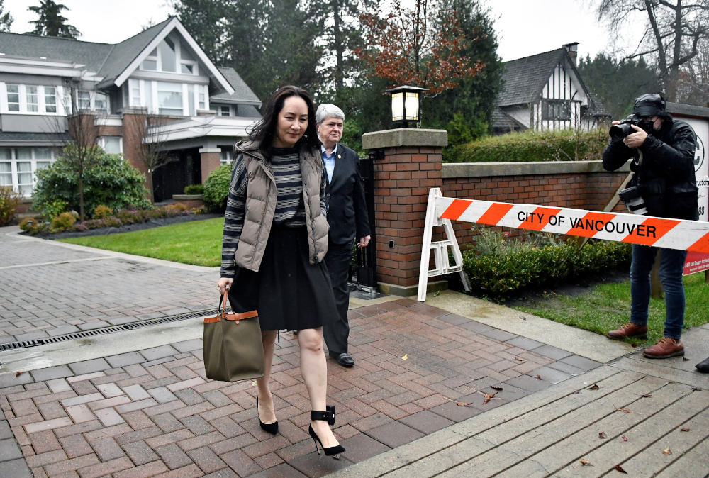 Huawei Technologies Chief Financial Officer Meng Wanzhou leaves her home to attend a court hearing in Vancouver, British Columbia, Canada December 7, 2020. — Reuters pic