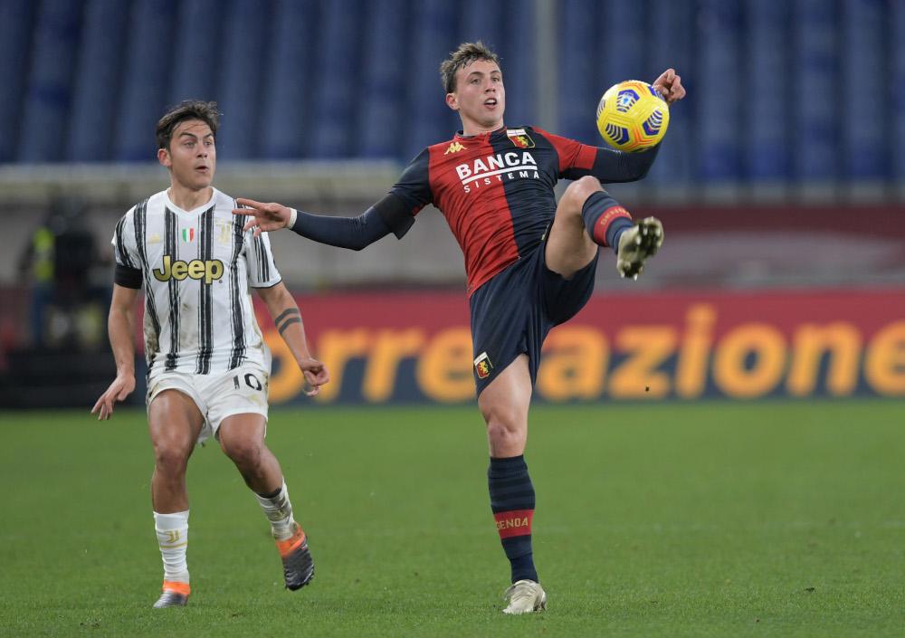 Genoa's Luca Pellegrini in action with Juventus' Paulo Dybala at the Comunale Luigi Ferraris, Genoa, Italy, December 13, 2020. — Reuters pic